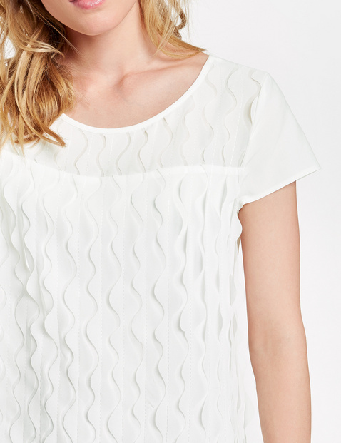 Blouse top with a wave design