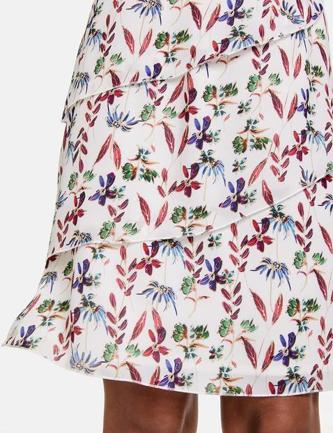 Skirt with asymmetric flounces