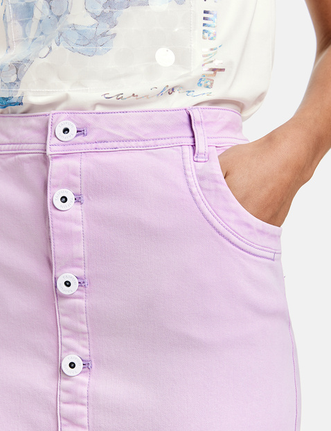 Mini skirt with a button placket
