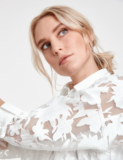 Lange blouse met transparant bloemenmotief