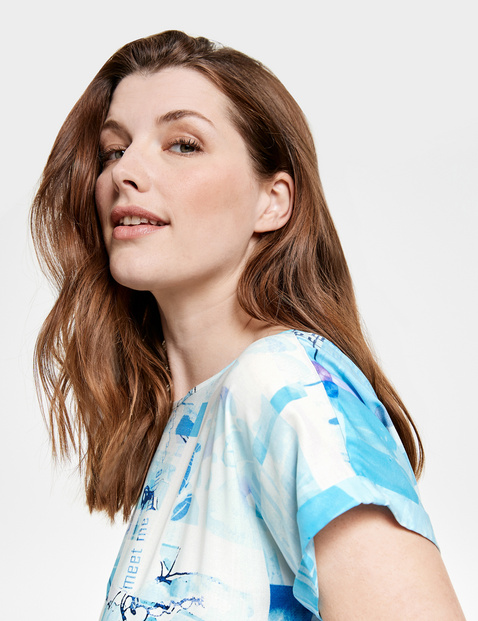 Blouse top with a panel print