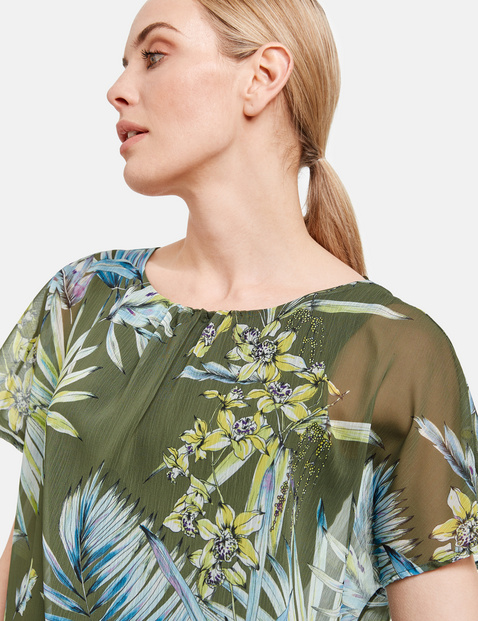 2-in-1 blouse top with a floral print