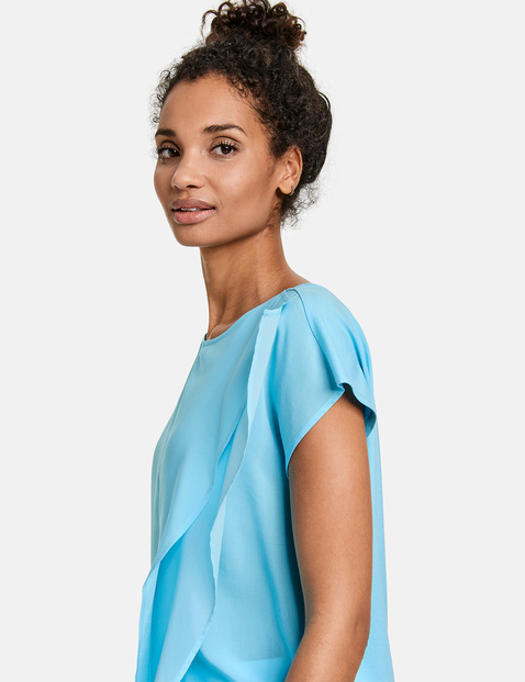 Blouse top with a chiffon flounce
