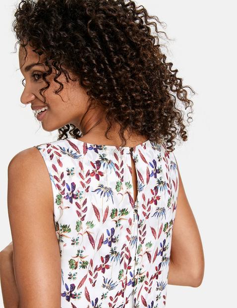 Szyfonowa sukienka z kwiatowym nadrukiem na całej powierzchni