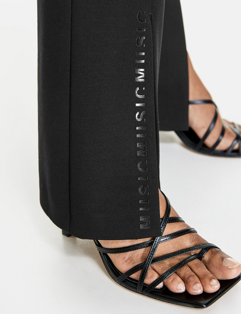 Kick-flared stretch trousers