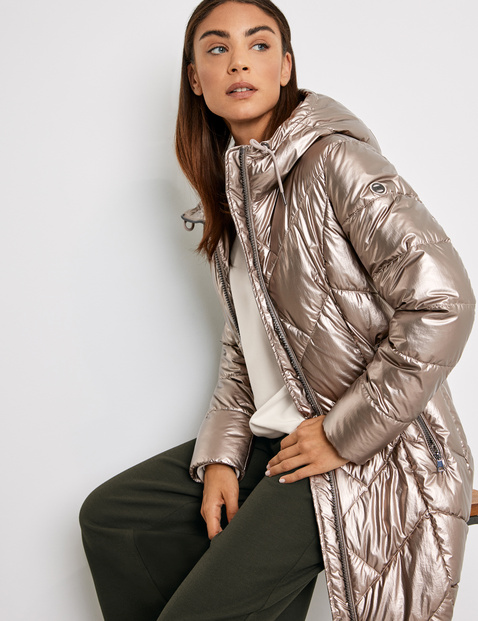Quilted coat with a metallic effect