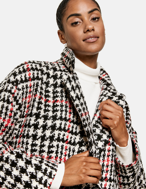 Coat with a check pattern