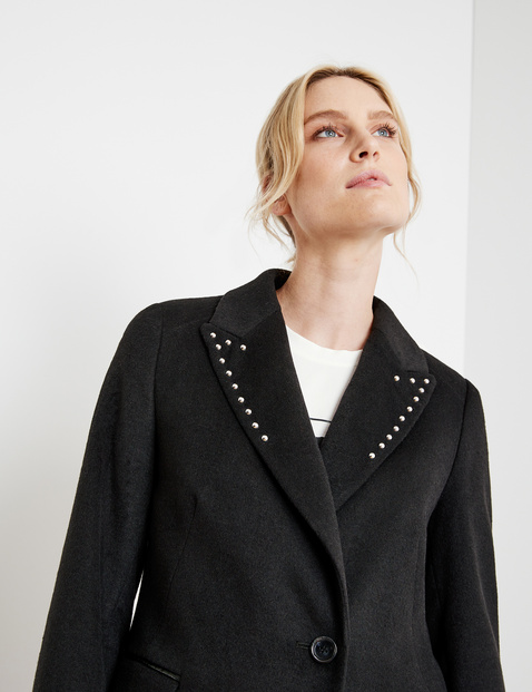 Short coat embellished with studs
