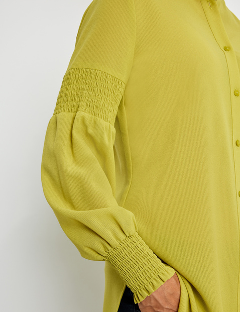 Blouse with smocked details