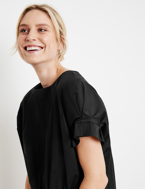 Blouse with a wrap effect at the back