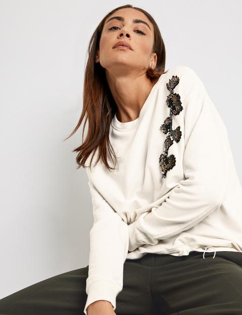 Sweatshirt with an appliqué