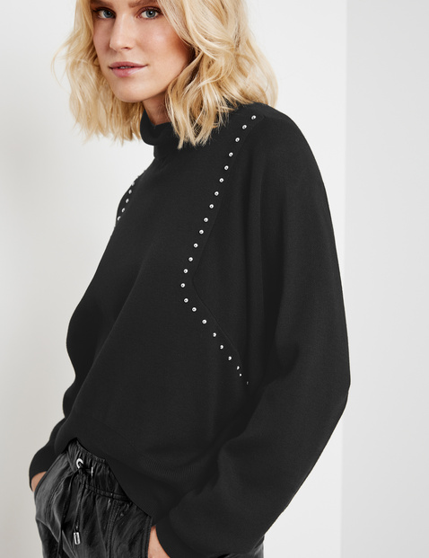 Polo neck jumper with studs