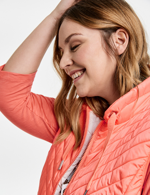 Lightweight quilted body warmer with a stand-up collar