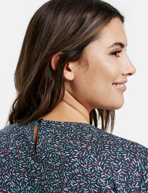 Blouse top with gathers at the hem
