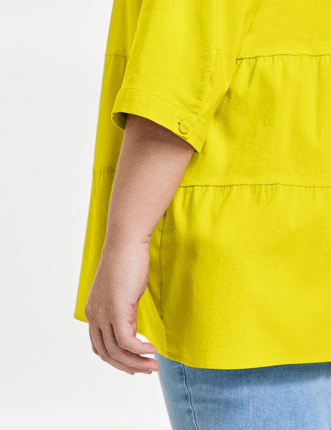 Flared organic cotton blouse