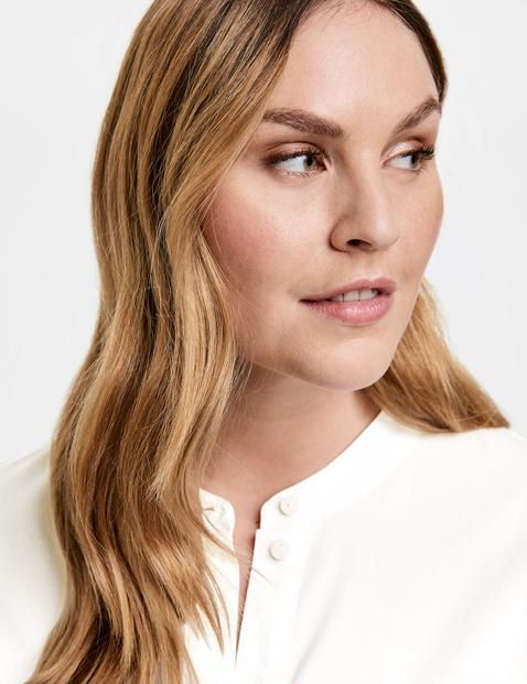 Uitlopende blouse van organic cotton