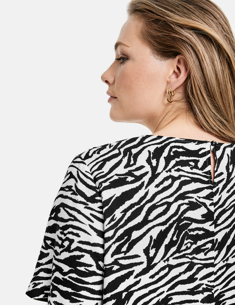 Blouse top with a zebra pattern