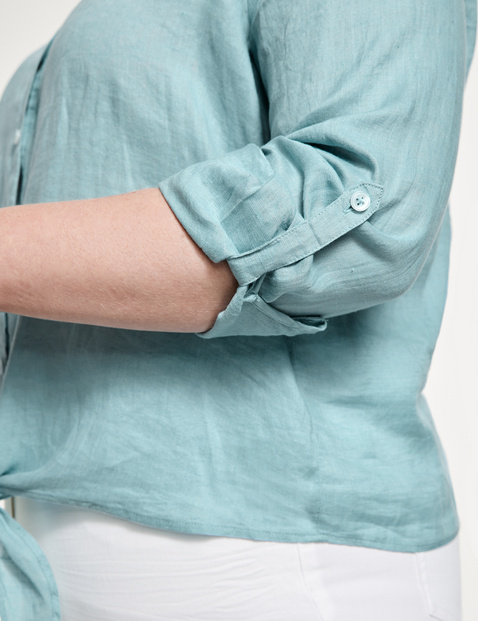 Linen blouse with a knotted hem