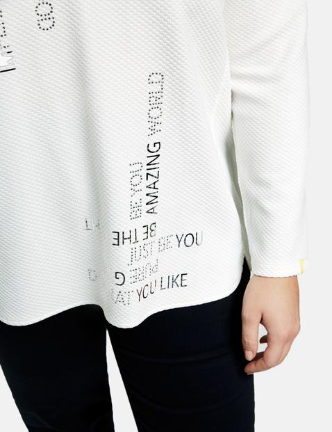 Koszulka z długimi rękawami, napisem i ozdobnymi kamykami