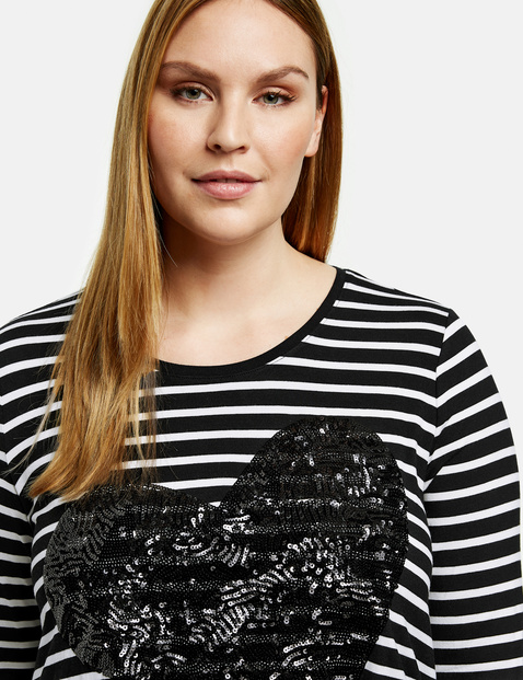 Striped top with a sequin heart