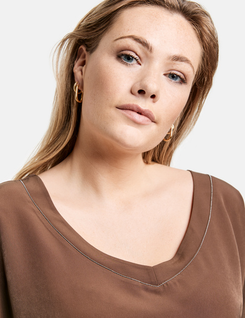 Blouse top with a V-neckline