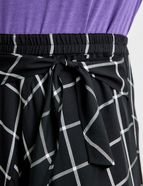 Woven skirt with a handkerchief hem and knotted detail