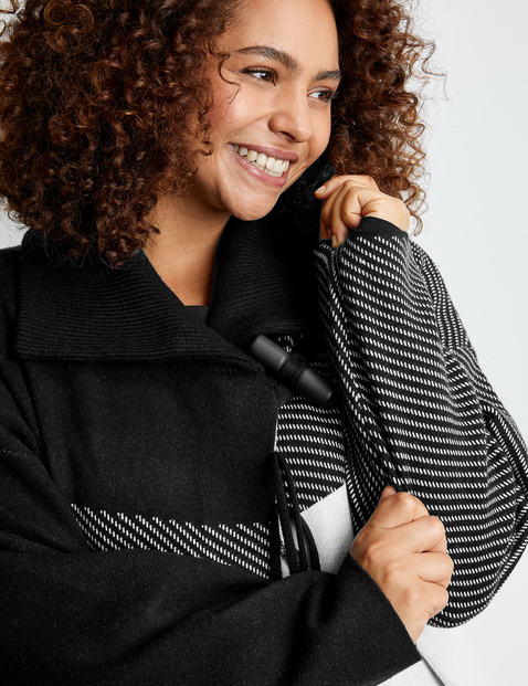 Knit coat with modern fringing