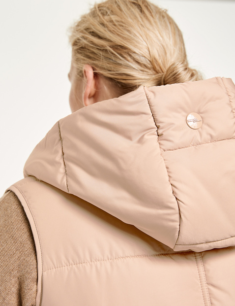 Long quilted body warmer with hood