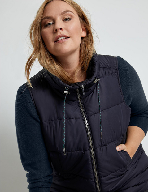 Long body warmer with a stand-up collar