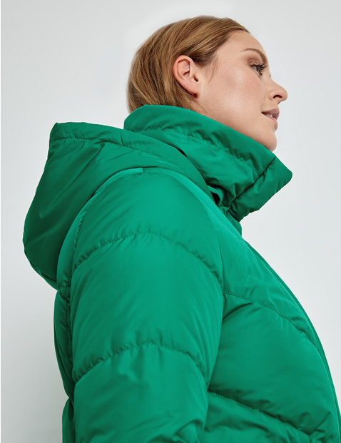 Quilted jacket with a concealed hood