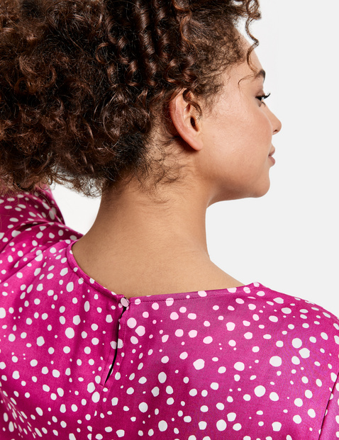 Blouse top with a polka dot print