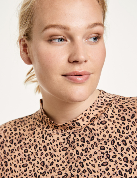 Animal print top with mid-length sleeves