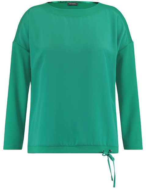 Long sleeve top with a drawstring