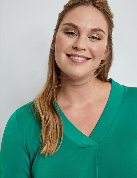 Figure-skimming top with a V-neckline