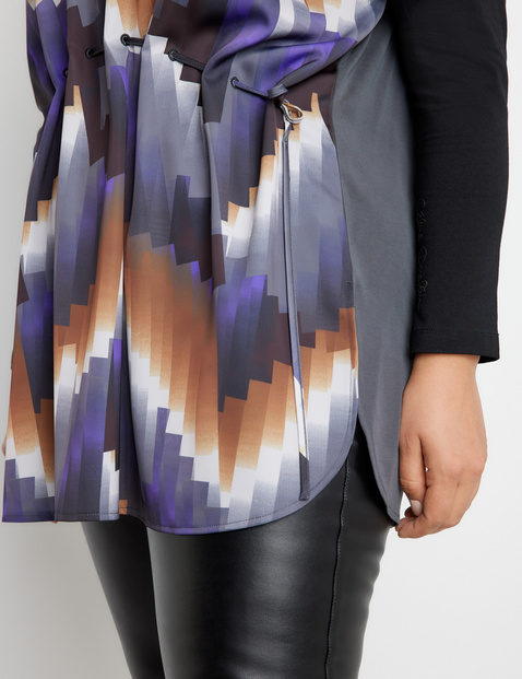 Tunic with an accentuated waist