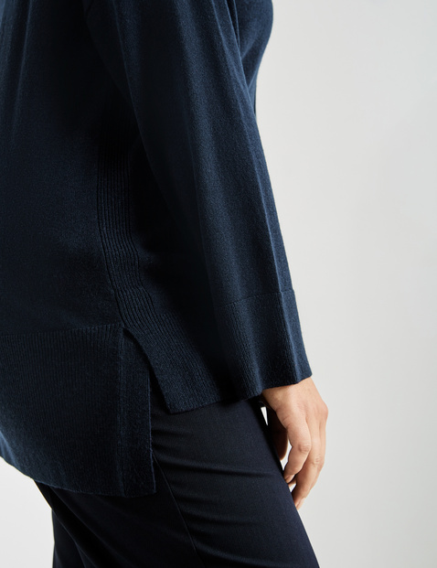 Polo neck jumper with a pocket