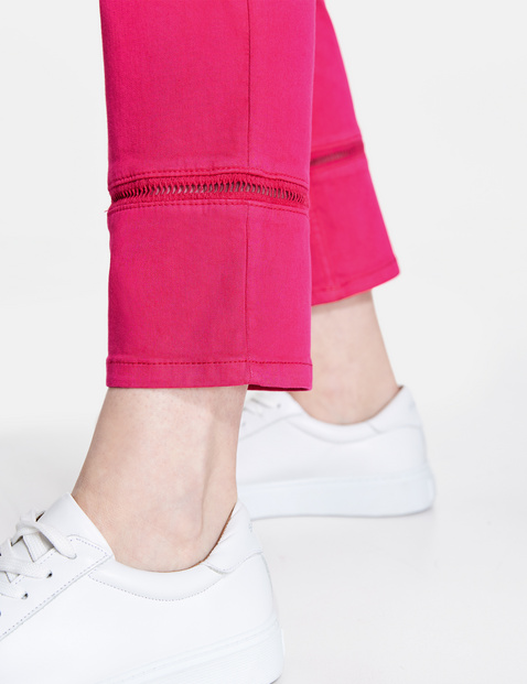 Trousers with decorative hems