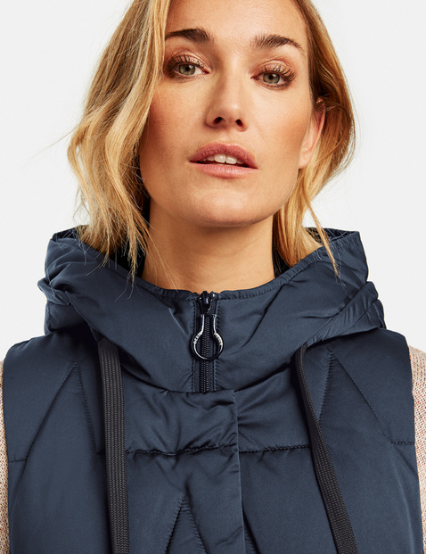 Long quilted body warmer