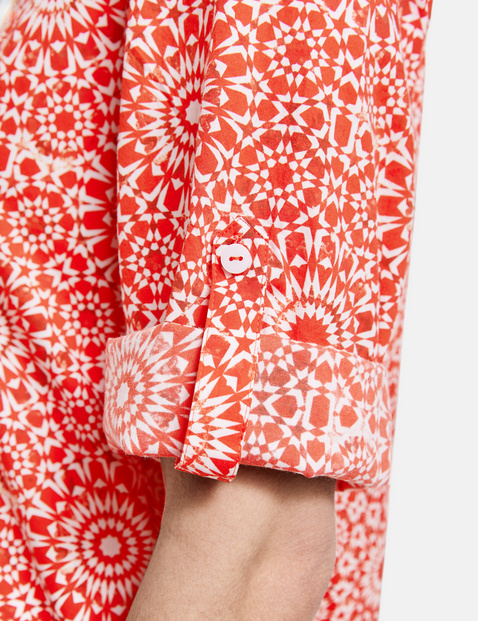 Blouse with an ornamental pattern