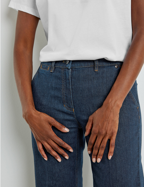 Jeans with pressed pleats