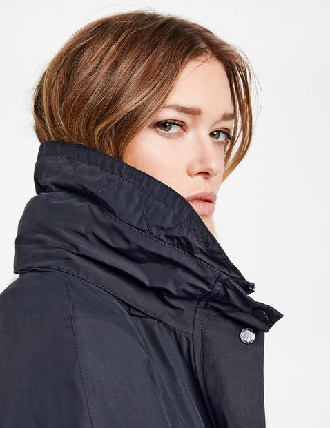 Korte mantel met coating