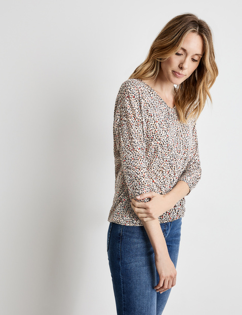 3/4 sleeve top with a burnout pattern