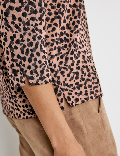 3/4 sleeve top with a leopard print pattern