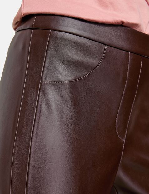 Slim-fitting trousers in faux leather