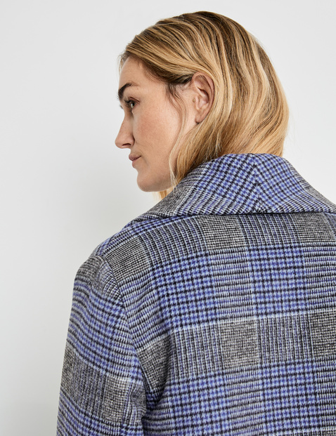 Coat with a frayed edge