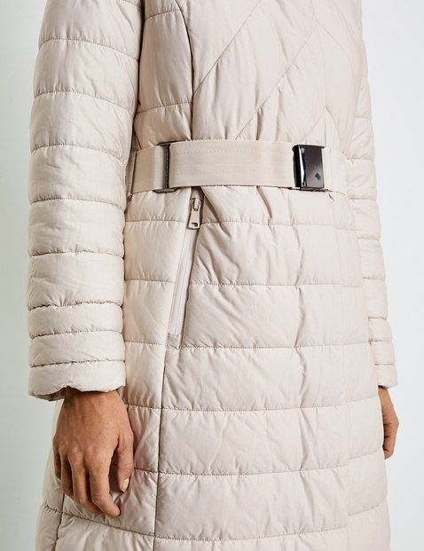 Quilted coat with a cinch belt
