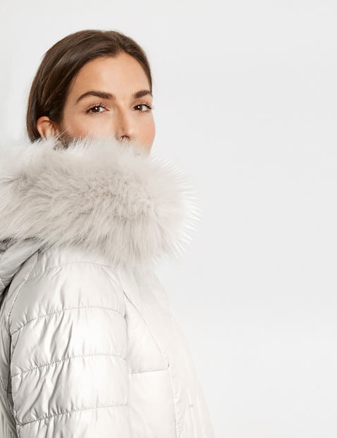 Quilted jacket with a fur hood