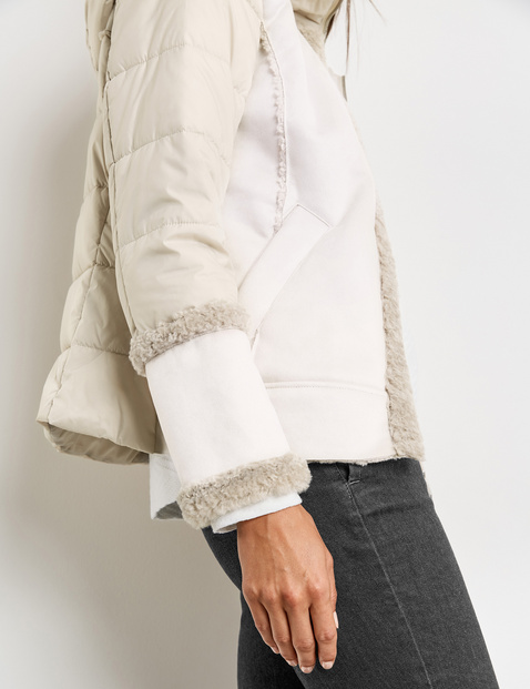 Quilted jacket with faux fur details