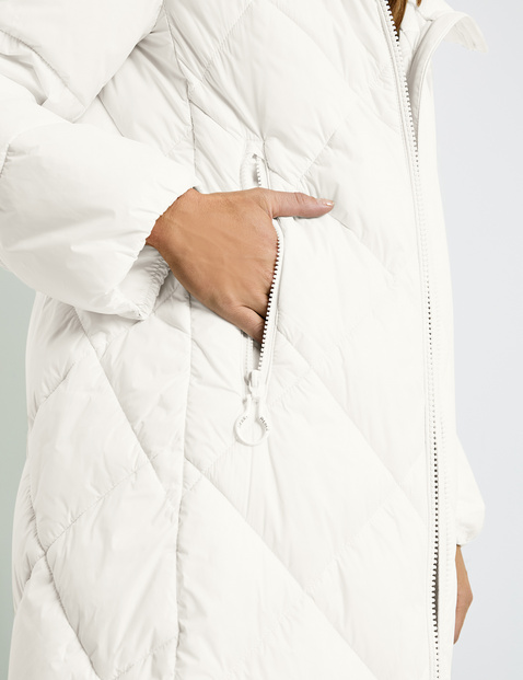 Coat with a quilted diamond pattern