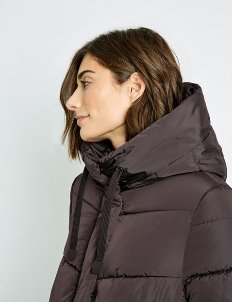 Quilted coat with a large hood